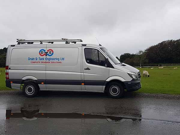 drain and tank engineering van on the road